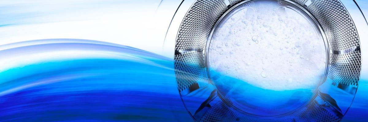 Une machine à laver et sa vague bleue